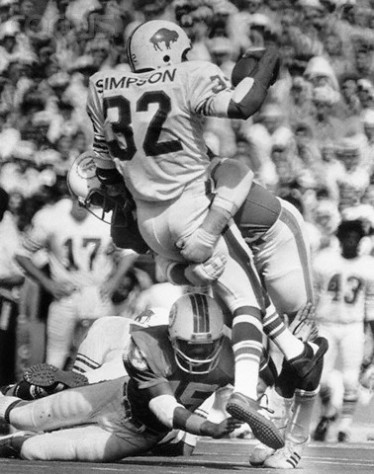 O.J. Simpson Tackled by Dolphin's Defense