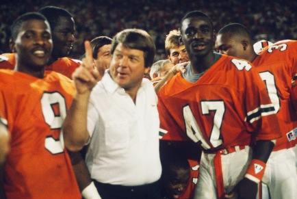 MIAMI - NOVEMBER 28: University of Miami Hurricanes head coach Jimmy Johnson celebrates with Michael Irvin #47 following the game against the Notre Dame Fighting Irish at the Orange Bowl on November 28, 1987 in Miami, Florida. Miami defeated Notre Dame 24-0. (Photo by Focus on Sport/Getty Images)