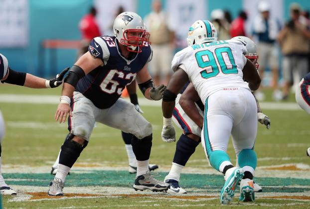 New England Patriots guard Dan Connolly (63) blocks Miami Dolphins nose tackle Earl Mitchell (90) during the NFL week 1 regular season football game against the Miami Dolphins on Sunday, Sept. 7, 2014 in Miami Gardens, Fla. The Dolphins won the game 33-20. (AP Photo/Paul Spinelli)