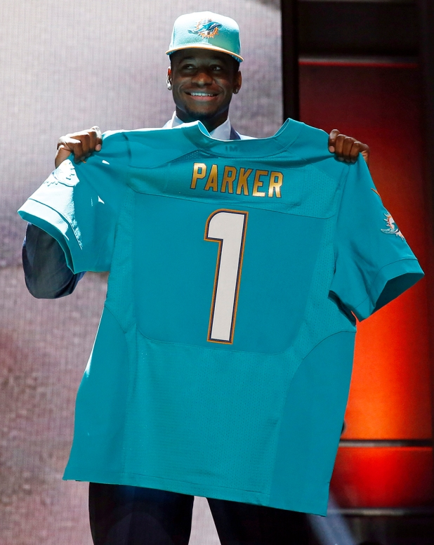 Louisville wide receiver Devante Parker poses for photos after being selected by the Miami Dolphins as the 14th pick in the first round of the 2015 NFL Draft,  Thursday, April 30, 2015, in Chicago. (AP Photo/Charles Rex Arbogast)