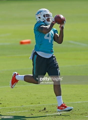 DAVIE, FL - MAY 8: Cedric Thompson #41 of the Miami Dolphins catches the ball during the rookie minicamp on May 8, 2015 at the Miami Dolphins training facility in Davie, Florida. (Photo by Joel Auerbach/Getty Images) *** Local Caption *** Cedric Thompson