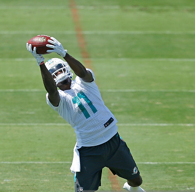 DAVIE, FL - MAY 9: DeVante Parker #11 of the Miami Dolphins catches the ball during the rookie minicamp on May 9, 2015 at the Miami Dolphins training facility in Davie, Florida. (Photo by Joel Auerbach/Getty Images) *** Local Caption *** DeVante Parker