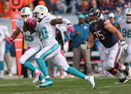CHICAGO, IL - OCTOBER 19:  Reshad Jones #20 of the Miami Dolphins runs with ball during the second quarter of a game against the Chicago Bears at Soldier Field on October 19, 2014 in Chicago, Illinois.  (Photo by Jonathan Daniel/Getty Images)