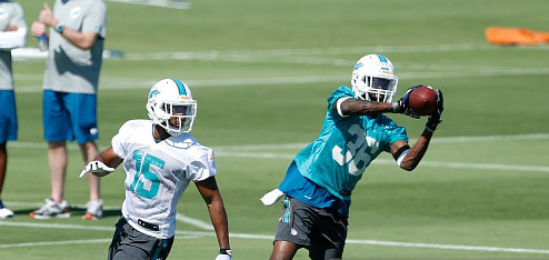 DAVIE, FL - MAY 8: Tony Lippett #36 intercepts the ball intended for Tyler McDonald #15 of the Miami Dolphins during the rookie minicamp on May 8, 2015 at the Miami Dolphins training facility in Davie, Florida. (Photo by Joel Auerbach/Getty Images) *** Local Caption *** Tyler McDonald;Tony Lippett