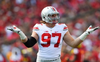 Oct 4, 2014; College Park, MD, USA; Ohio State Buckeyes defensive lineman Joey Bosa (97) celebrates after sacking Maryland Terrapins quarterback C.J. Brown (not pictured) in the second quarter at Byrd Stadium. Mandatory Credit: Tommy Gilligan-USA TODAY Sports