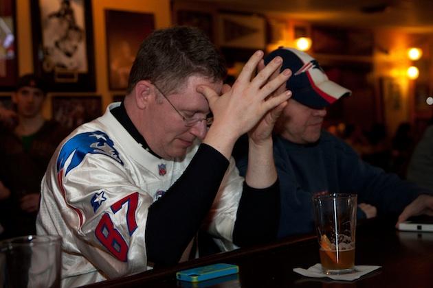 New England Patriots fans watch Super Bowl XLVI in Boston, MA