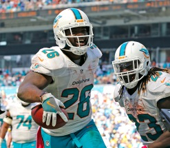 Miami Dolphins' Damien Williams (28), celebrates with Jay Ajayi (23), after Williams scored a second quarter touchdown against the Pittsburgh Steelers on Sunday, Oct. 16, 2016 at Hard Rock Stadium in Miami Gardens, Fla. (Charles Trainor Jr./Miami Herald/TNS)
